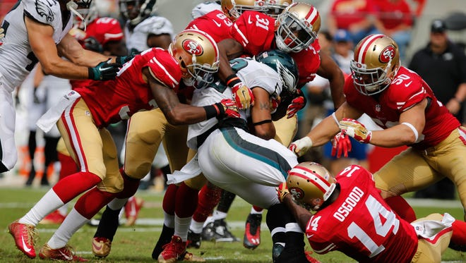 San Francisco limited Philadelphia's high-powered offense to 213 yards.