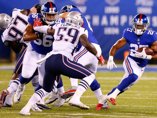 Aug 30, 2018; East Rutherford, NJ, USA; New York Giants running back Jhurrell Pressley (27) rushes for yardage against New England Patriots during second half at MetLife Stadium. Mandatory Credit: Noah K. Murray-USA TODAY Sports