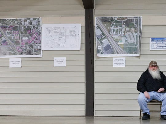 Hagar Nelson, of Two Rivers, participates in the open house regarding Meijer's proposal at the Expo Merchants Building on Jan. 7. Behind Nelson are designs of potential developments at the Expo Grounds and the Meijer grocery store.