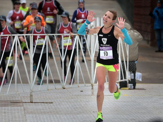Taylor Hoover of Colorado Springs notched a personal best time to win the women's division of the St. Jude Memphis Marathon. As the largest single fundraisng event for St. Jude Children's Research Hospital, organizers were expecting over 22,000 runners at this years event.