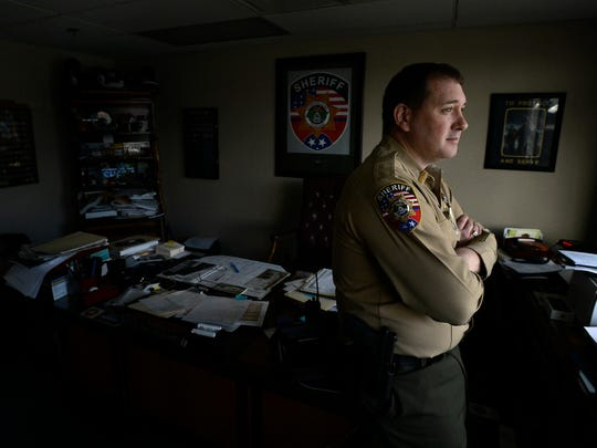In this Jan. 27, 2016 photo, Rutherford County Sheriff Robert F. Arnold stands in his office in Murfreesboro, Tenn.