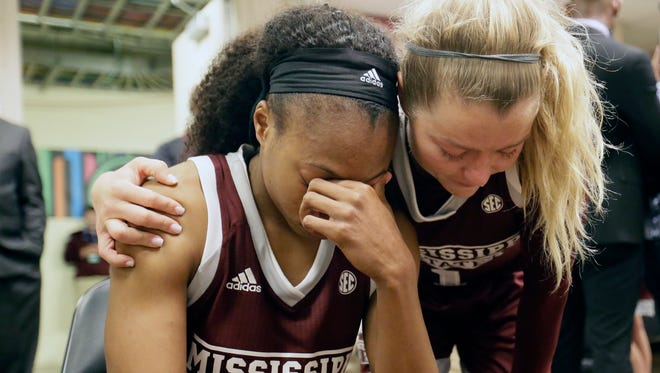 Mississippi State guard Morgan William, left, is consoled by teammate Blair Schaefer, right, the daughter of head coach Vic Schaefer, in the locker room after the team's loss to South Carolina in the final of the NCAA women's Final Four college basketball tournament, Sunday, April 2, 2017, in Dallas.