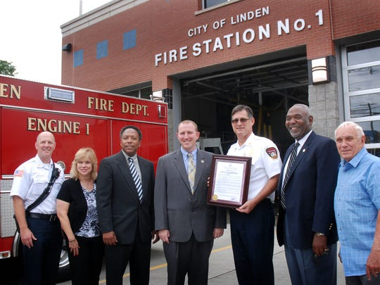 Union County Freeholder Christopher Hudak presented a resolution to Linden Fire Chief Joseph Dooley congratulating the Linden Fire Department on celebrating its 100th anniversary earlier this month. From left: Linden Deputy Chief Kevin Brady, Councilwoman Michele Yamakaitis, Mayor Derek Armstead, Freeholder Hudak, Linden Fire Chief Dooley, Councilman Monty Brooks and Councilman Robert J. Sadowski. The Linden Fire Department celebrated 100 years of service with a parade on July 16. The parade was followed by an anniversary party at the Robert Wood Bauer Promenade.