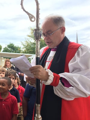 Bishop John Bauerschmidt, of the Episcopal Diocese of Tennessee, leads students of the new Episcopal School of Nashville in prayer during the school blessing Friday, Oct. 14, 2016.
