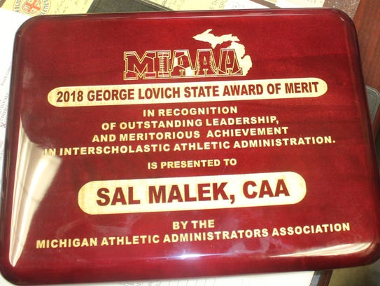 Sal Malek's State Award of Merit plaque up close.
