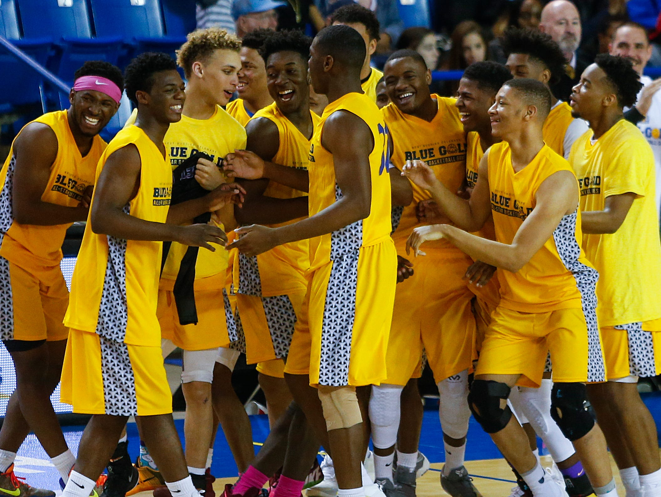 Gold celebrates its win, 92-91, in the Blue-Gold All-Star Basketball game at the Bob Carpenter Center Saturday.