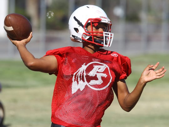 Palm Springs High School football players practice
