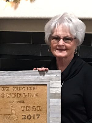 Carolyn Chance, right, accepts the 2017 CowBelle of the Year award from Lyn Greene of the Chuckwagon CowBelles.