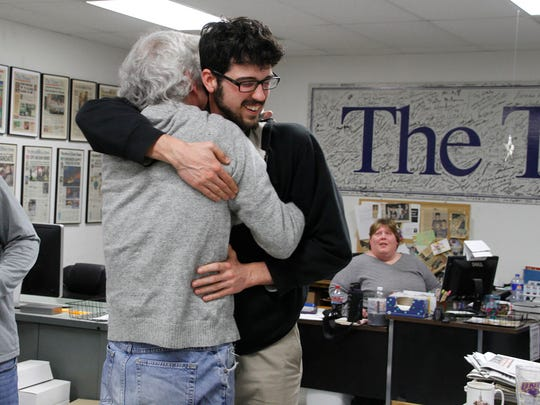 Art Cullen, left, hugs his son Tom at The Storm Lake Times office in Storm Lake after learning that Art had won a Pulitzer Prize for Editorial Writing on Monday, April 10, 2017.