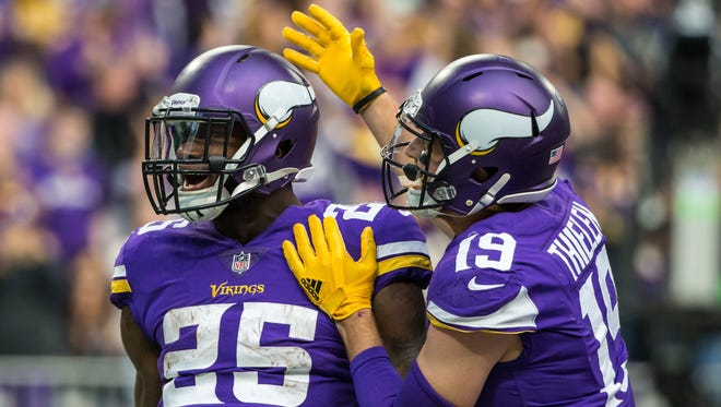 The Minnesota Vikings, featuring running back Latavius Murray, left, and wide receiver Adam Thielen will kick off the Thanksgiving Day slate against the Lions in Detroit.