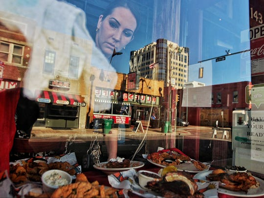 BB King Club Supervisor Michelle Martinez cleans the windows at the front of the club on Beale Street. The city of Memphis is looking for a new management firm for Beale Street to take over the duties that John Elkington used to perform. (Jim Weber/The Commercial Appeal)