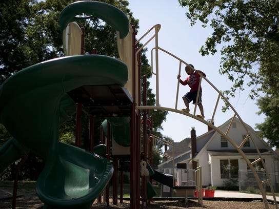 Eric Rodriguez, 5, climbs a jungle gym at Johnson Reeves