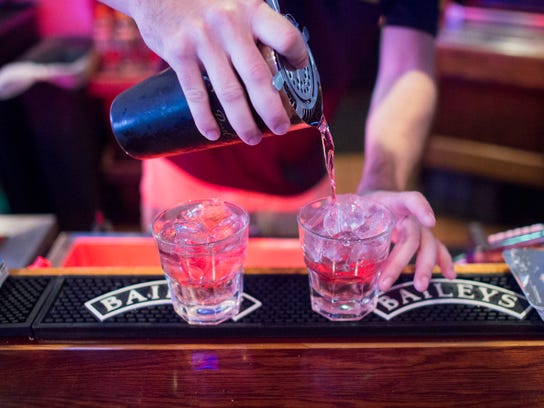 Bartender Robbie Gilroy pours two Cape Codders at Buxy's