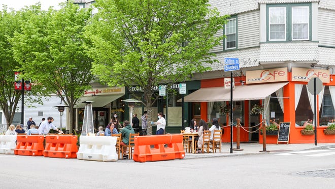 Businesses along Broadway take coronavirus-related measures to keep customers outside.