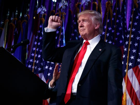 Donald Trump pumps his fist during an election night