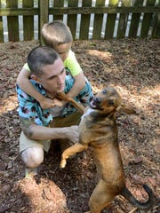 """Steve Matyas and his son Connor play with """"George"""""""