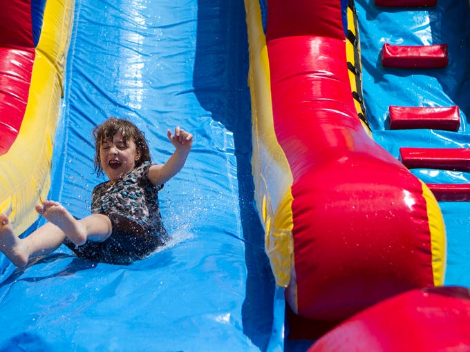 Sidney Painter cools off on an inflatable water slide