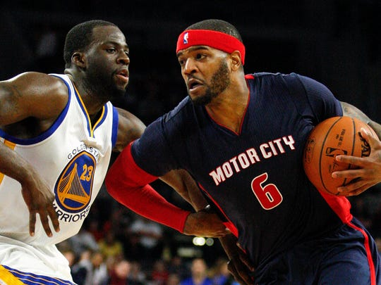 Josh Smith is defended by Warriors forward Draymond Green on Nov. 30, 2014.