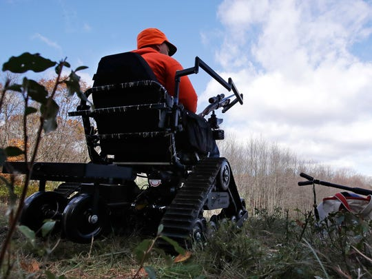 In this Friday, Nov. 4, 2016 photo, paraplegic hunter