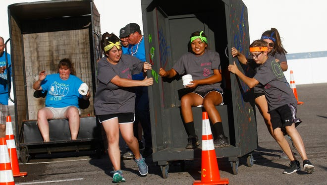 Pioneer Adultz 4-H and members of Bloomfield FFA race against each other on Monday during the San Juan County Fair Outhouse Race at McGee Park in Farmington.