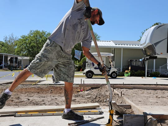 A contractor prepares the foundation for a new manufactured home at the Resort at Carefree Boulevard in greater Fort Myers, Florida; one of a scattering of women's communities across the country.