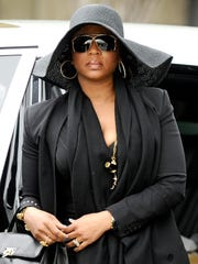 Snoop Dogg's wife Shante Broadus was photographed stepping out of the Phantom at a funeral service for Nate Dogg in 2011.