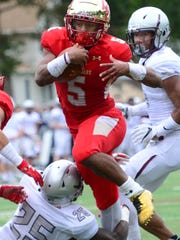 Josh McKenzie, of Bergen Catholic, breaks a tackle by Zamir Mickens, of St. Peter's Prep, to score a touchdown in the second quarter. Bergen Catholic vs St. Peter's Prep High School Football game on Saturday, October 14th, 2017.