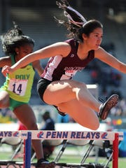 Katherine Muccio, of Ridgewood, heads to a 62.5 second finish in the 400 meter intermediate hurdles.  Muccio's time was good for 10th place at Penn Relays.  She was able to beat Kenya Payne, of Long Beach Poly (Ca.), who came in 13th place.