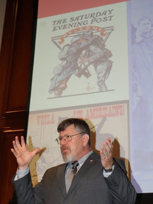 Military expert Richard Faulkner addresses a big crowd at the state Archives Building in Montgomery over the weekend. Alvin Benn/Special to the Advertiser