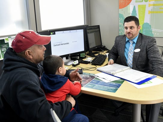 Samuel Hernandez, a senior tax preparer, meets with