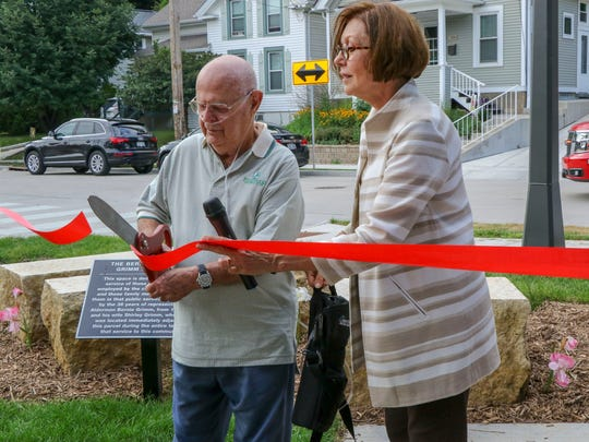 Former Alderman Bernie Grimm cuts the ribbon next to Wauwatosa Mayor Kathy Ehley. A civic garden was dedicated to Grimm and his late wife for his years of service.
