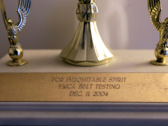 "A few years ago, Mark Hubbard received a trophy for ""Indomitable Spirit"" after finally breaking a board in tae kwon do."