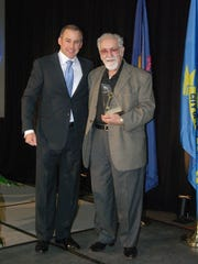 Westland Mayor William Wild (left) presenting Sam Corrado with  key to the city in 2011.