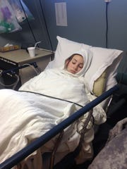 Payton Reuter lays in a hospital bed after surgery on Jan. 22. The surgery was her second procedure to reconstruct the cartilage in her right knee. Coming out of surgery, she was freezing cold.
