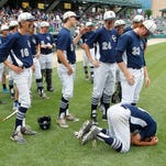 Dylan Kiracofe drops to his knees after Central Catholic fell to South Spencer 8-2 in the Class 2A State Championship Saturday, June 20 2015, at Victory Field in Indianapolis.