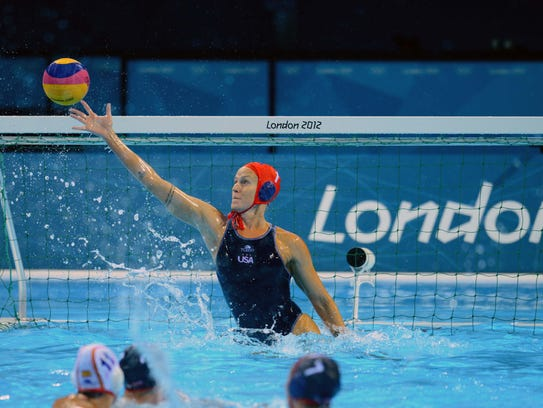 Betsey Armstrong defends a shot on goal for Team USA in a match against Spain during the preliminary round of the 2012 Olympic Games in London.