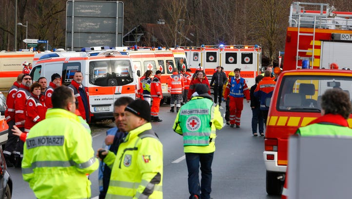 Rescue personnel wait in Bad Aibling, Germany, Tuesday,