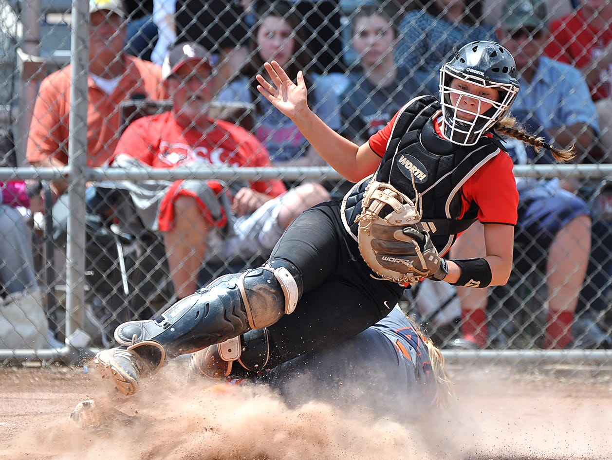 Stewarts Creek catcher Ciera Dobbins goes down after a close play at home during the Lady Red Hawks 4-2 loss to Dickson County in the AAA State Championships at Spring Fling 2016 Wednesday, May 25, 2016 in Murfreesboro, Tenn.