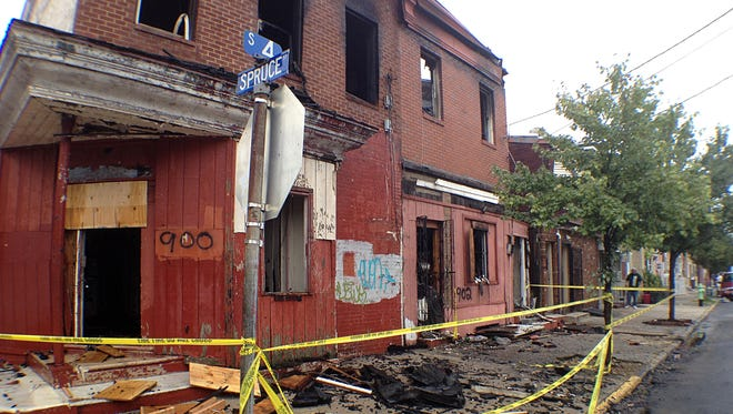 Authorities say a two-alarm fire on the 900 block of South 4th Street in Camden led to a partial building collapse early Friday morning.