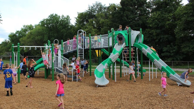 Kelly Elementary students try out the new playground after its unveiling on Aug. 15. The playground was designed as a Passion Based Learning project by last year's fifth-graders.