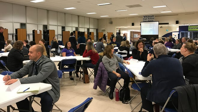 Participants in Whitnall's community conversation rotated in groups through three tables, each with a different discussion topic.
