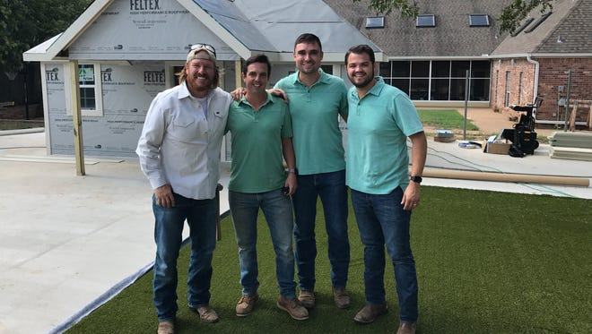 Left to right, home improvement host Chip Gaines, Wichitan George Berre, owner of ForeverLawn Wichita Falls, and Nick Pavey and Jason Delph of ForeverLawn Texas stand in front of a Waco home.