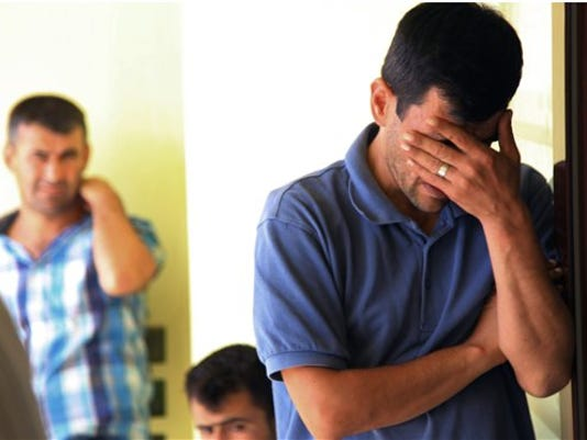 Abdullah Kurdi, 40, father of Syrian boys Aylan, 3, and Galip, 5, who were washed up drowned on a beach near Turkish resort of Bodrum on Wednesday, cries as he waits for the delivery of their bodies outside a morgue in Mugla, Turkey, Thursday, Sept. 3, 2015.
