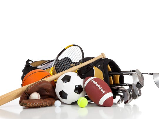 Assorted sports equipment on a white background with