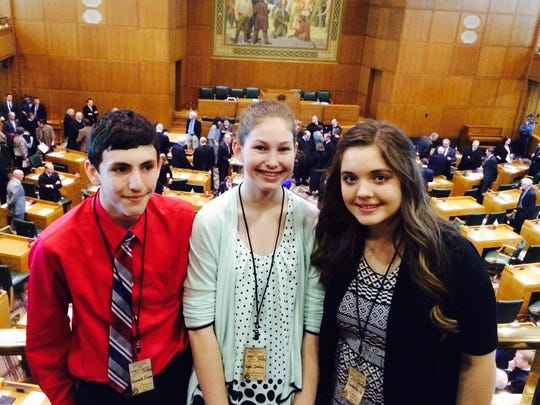 From left, Kenneth Fisher, 13, Taylor Snoha, 14 and Samantha Urrutia, 14, signed up to be honorary pages at the Capitol weeks ago, and then drew the lucky straw to be introduced on the House floor the day Kate Brown became the 38th governor of the state.