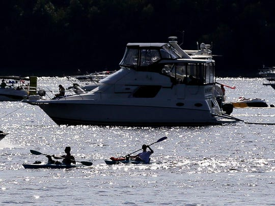 Boats and recreationists fill the St. Croix River in Hudson, Minn. A scenic stretch of the river north of Stillwater is one of 581 waterways that Minnesota has added to its list of waters that don't meet state pollution standards.