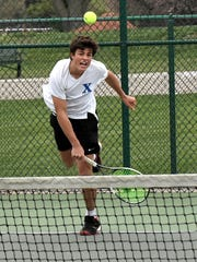 Max DeCurtins of St. Xavier gives his all while serving