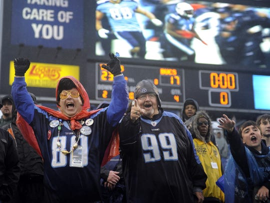 Titans fans Rick Cawthorn and Tom Ballman celebrate