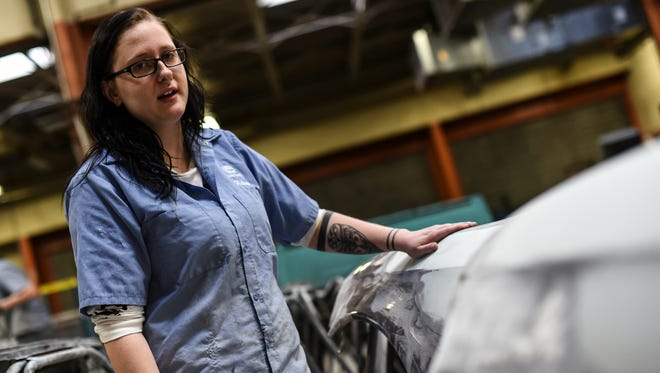 Kelsi Kline, 18, a senior at Elco High School and student in the auto body shop at the Lebanon County Career and Technology Center talks about the fender she is working on Thursday, January 14, 2016. Kline is one of the four girls in the auto body course at the CTC.