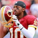 Washington Redskins quarterback Robert Griffin III gets ready for a game in 2012.